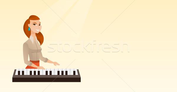 Nő játszik zongora fiatal kaukázusi zenész Stock fotó © RAStudio