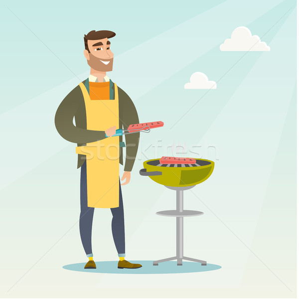 Man cooking steak on barbecue grill. Stock photo © RAStudio