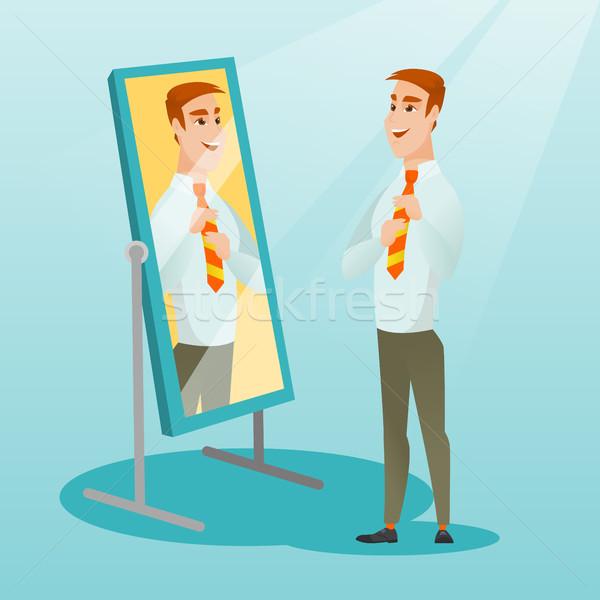 Business man looking himself in the mirror. Stock photo © RAStudio