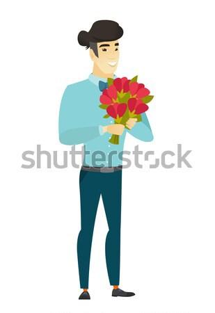Asian groom holding a bouquet of flowers Stock photo © RAStudio