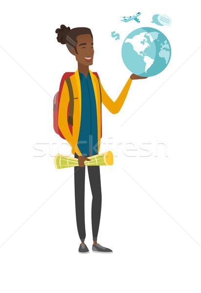 Młodych Afryki podróżnik Pokaż świecie Zdjęcia stock © RAStudio
