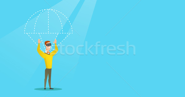Caucasian man in vr headset flying with parachute. Stock photo © RAStudio