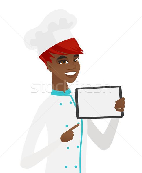 Smiling chef cook holding tablet computer. Stock photo © RAStudio