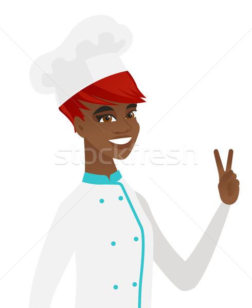 African-american chef cook showing victory gesture Stock photo © RAStudio
