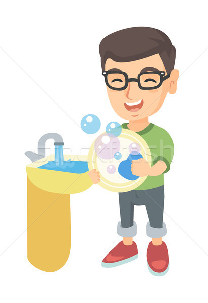 Little caucasian boy washing dishes in the sink. Stock photo © RAStudio
