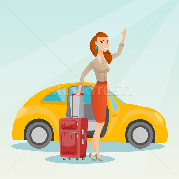 Young caucasian woman waving in front of car. Stock photo © RAStudio