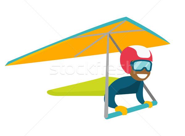 Black woman flying on hang-glider. Stock photo © RAStudio
