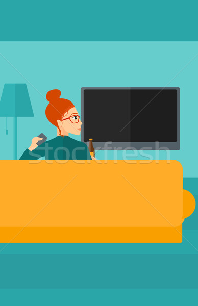 Nő néz tv ül kanapé nappali Stock fotó © RAStudio