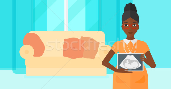 Pregnant woman with ultrasound image. Stock photo © RAStudio