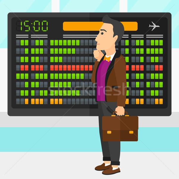 Férfi néz menetrend tábla repülőtér vektor Stock fotó © RAStudio