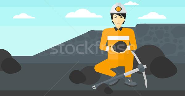 Miner holding coal in hands. Stock photo © RAStudio