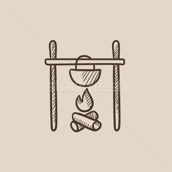 Cooking in cauldron on campfire sketch icon. Stock photo © RAStudio