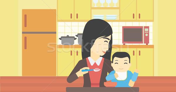 Anya etetés baba ázsiai otthon fiatal Stock fotó © RAStudio