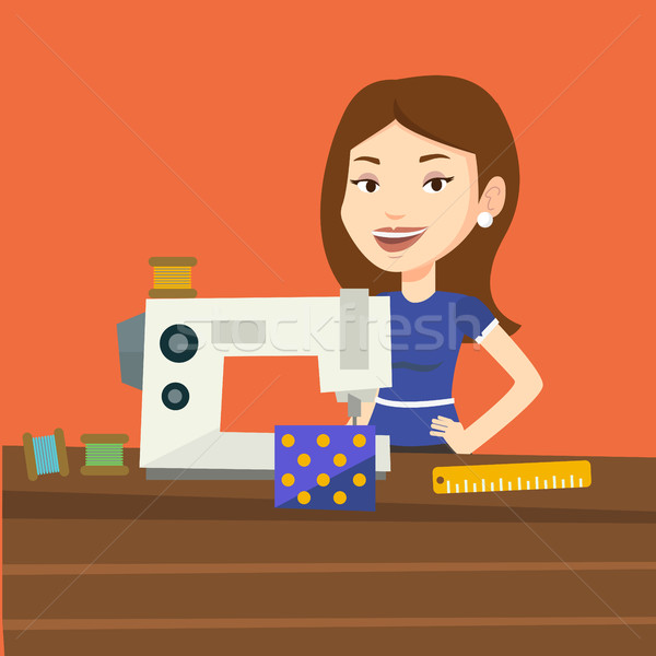 Seamstress using sewing machine at workshop. Stock photo © RAStudio