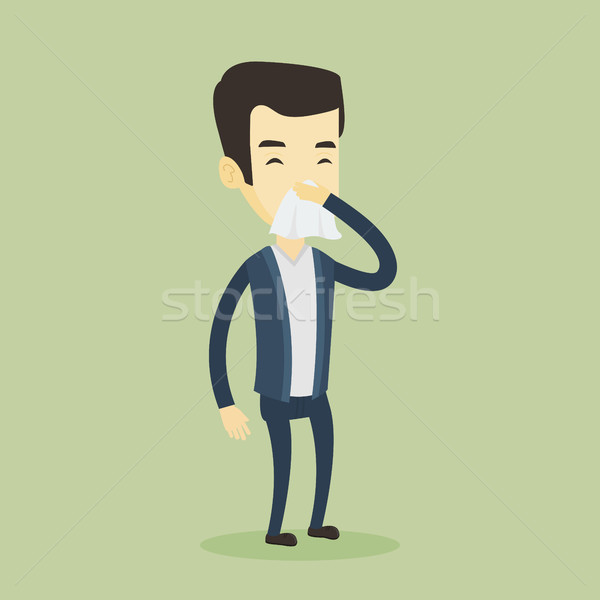 Young asian sick man sneezing. Stock photo © RAStudio