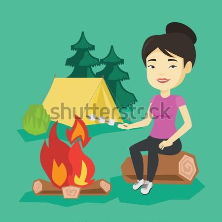 Mulher sessão fogueira camping Foto stock © RAStudio