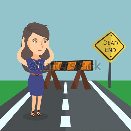 Business woman looking at road sign dead end. Stock photo © RAStudio