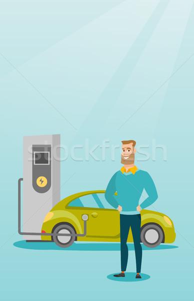 Elektrikli araba genç kafkas adam istasyon ayakta Stok fotoğraf © RAStudio