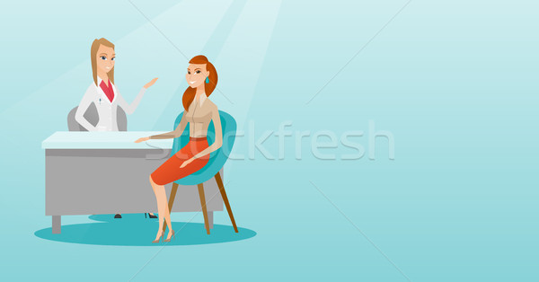 Doctor consulting female patient in office. Stock photo © RAStudio