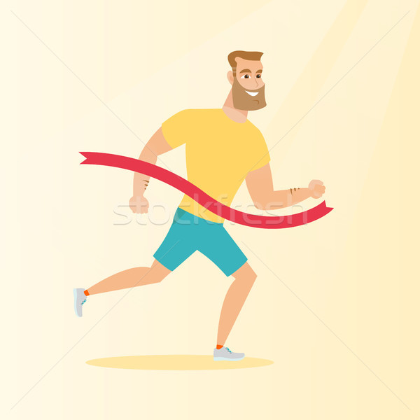 Young caucasian sportsman crossing finish line. Stock photo © RAStudio