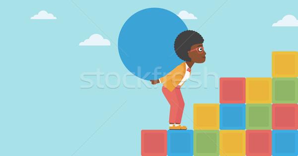 Woman carrying concrete ball uphill. Stock photo © RAStudio