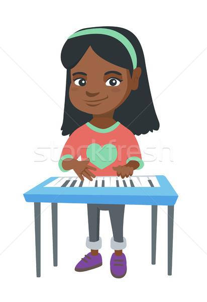 Little african-american girl playing the piano. Stock photo © RAStudio