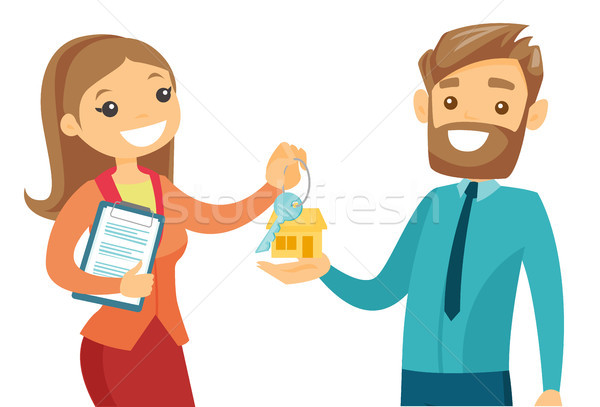 Real estate agent giving house key to a client. Stock photo © RAStudio
