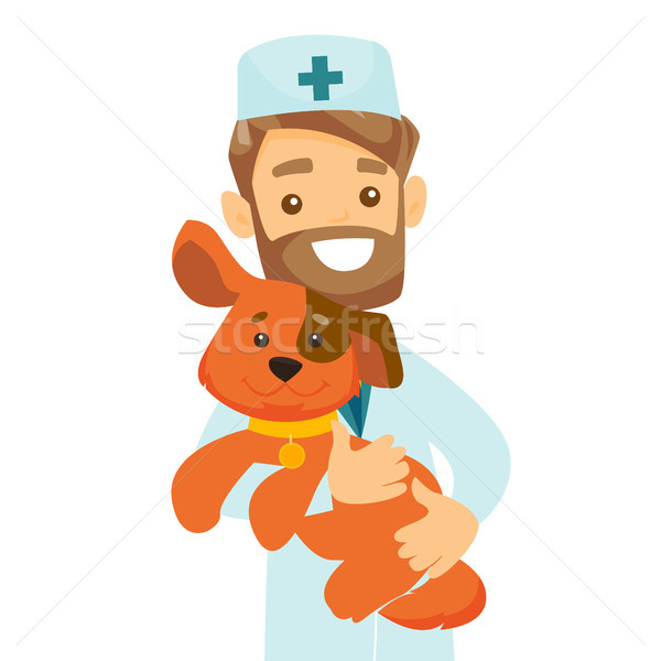 Caucasian white veterinarian with dog in hands. Stock photo © RAStudio