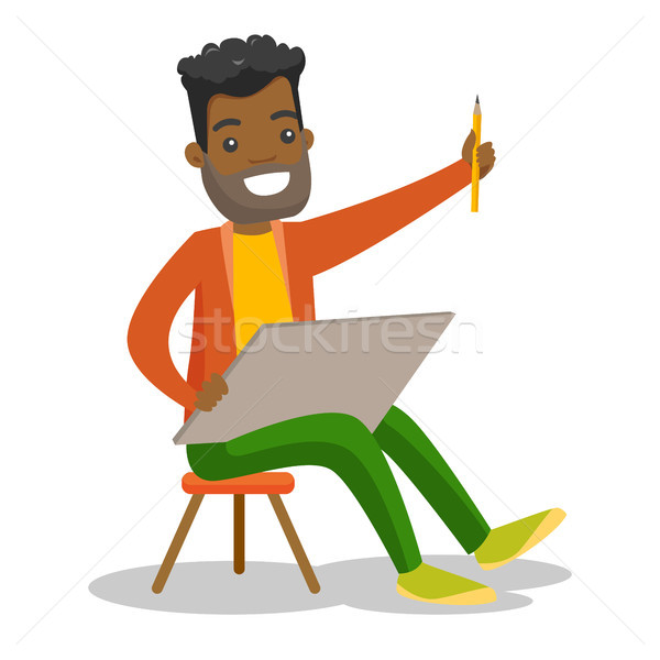 Young african-american artist painting a picture. Stock photo © RAStudio