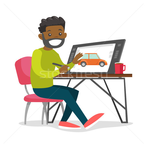 A black man graphic designer works at the office desk. Stock photo © RAStudio