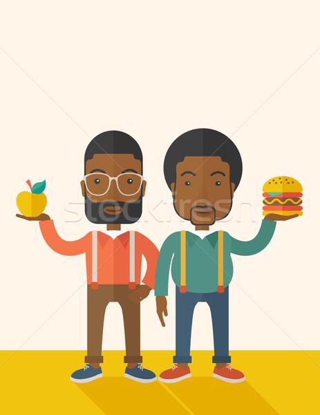 Two black businessmen comparing apple to hamburger. Stock photo © RAStudio