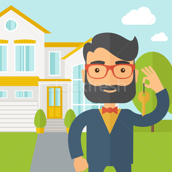 Real estate agent holding a key infront of the house Stock photo © RAStudio