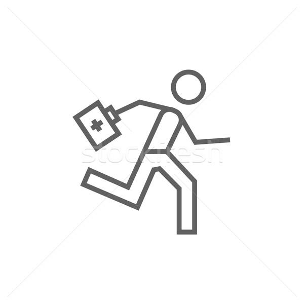 Paramedic running with first aid kit line icon. Stock photo © RAStudio