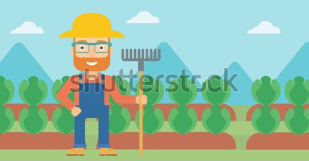 Farmer with pruner in garden. Stock photo © RAStudio