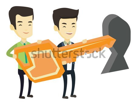 Businesspeople holding key in front of keyhole. Stock photo © RAStudio