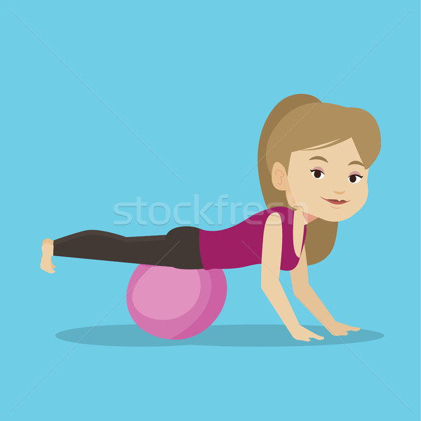 Young woman exercising with fitball. Stock photo © RAStudio