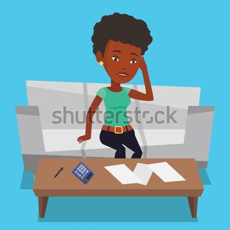 Ongelukkig afrikaanse vrouw boekhouding home Stockfoto © RAStudio