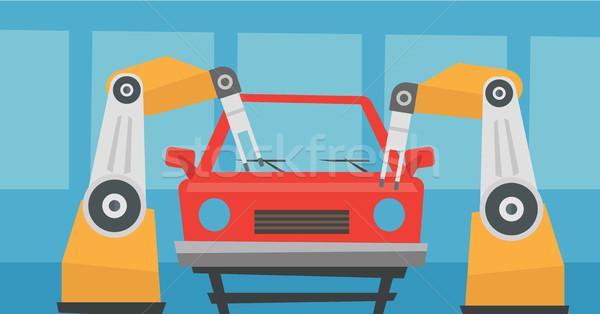 Robotic arm assembling car in assembly shop. Stock photo © RAStudio
