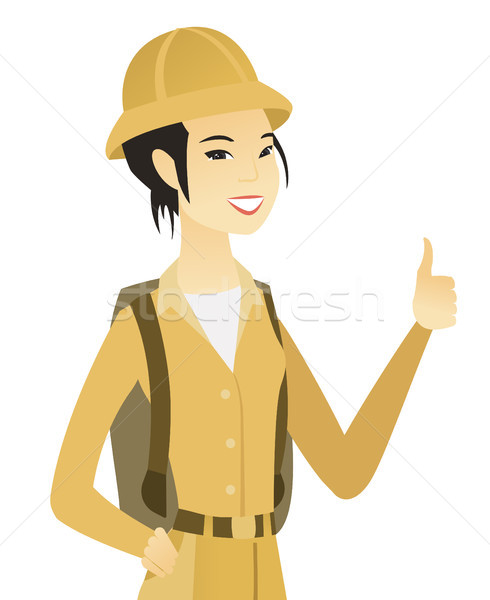 Young asian traveler giving thumb up. Stock photo © RAStudio