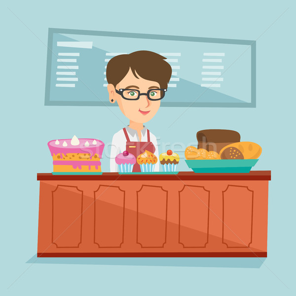 Worker standing behind the counter in the bakery. Stock photo © RAStudio