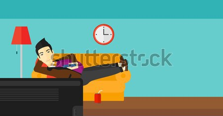 Man lying on sofa with many gadgets. Stock photo © RAStudio