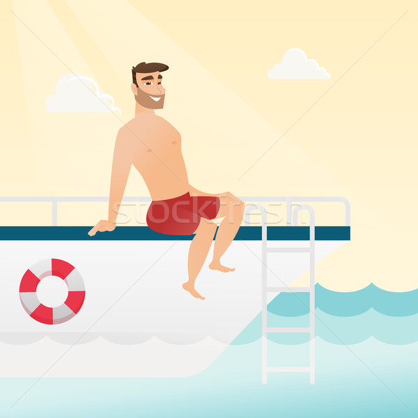 Young caucasian man tanning on the yacht. Stock photo © RAStudio