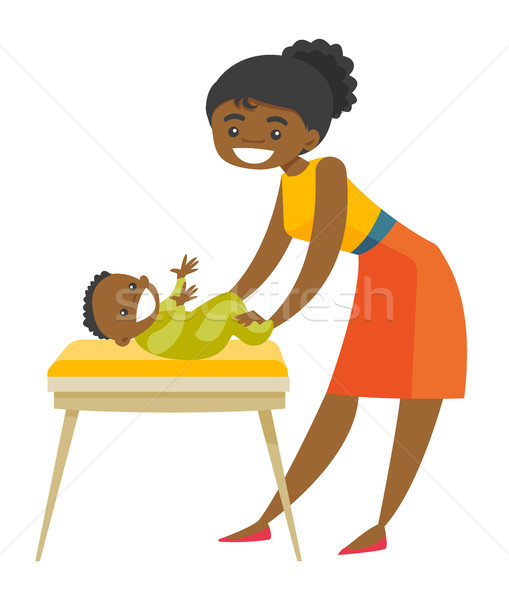 Young african-american mother taking care of baby. Stock photo © RAStudio
