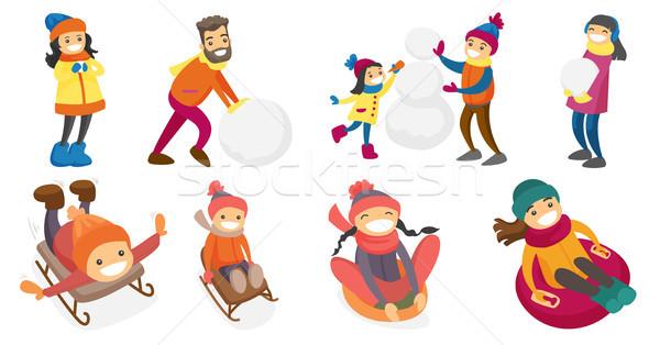 Young caucasian white people playing in snow set. Stock photo © RAStudio