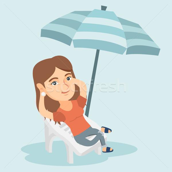 Young caucasian woman relaxing on the beach chair. Stock photo © RAStudio