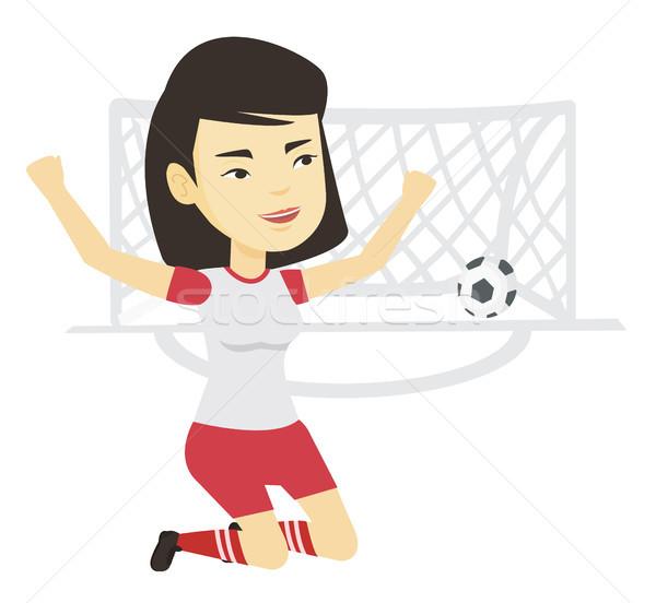 Soccer player celebrating scoring goal. Stock photo © RAStudio