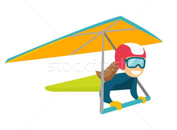 Caucasian white woman flying on hang-glider. Stock photo © RAStudio