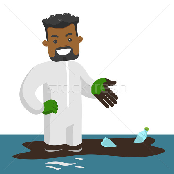 Man standing in water with oil spill and bottles. Stock photo © RAStudio