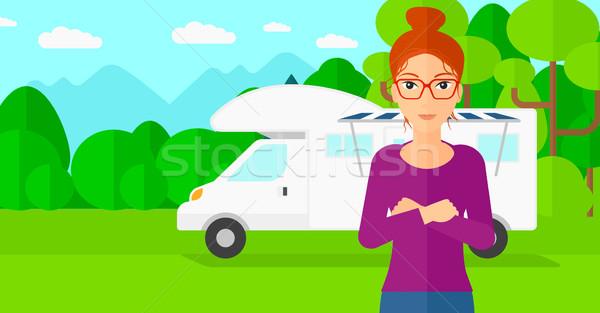 Woman standing in front of motor home. Stock photo © RAStudio