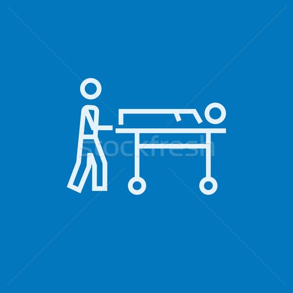 Man pushing stretchers line icon. Stock photo © RAStudio